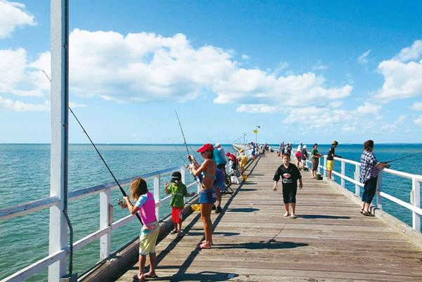 Fishing off the Urangan Pier, popular for visitors and locals
